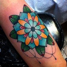 Flower tattoo by Alex Strangler