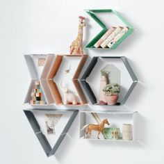Shelfie! I spy with my little eye a shelf that has three sides.  Wait, now it has four.  No, now it has six.  Hmmm, this must be one of those magical shelves that can change its appearance.  These hinged metal wall shelves can be hung in multiple shapes like a rectangle, triangle or even an arrow.  Choose from a variety of stunning finishes.