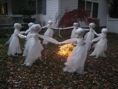 Just get yourself some: Cheap Plastic Drop Cloths; White paper, newspaper or even leaves to stuff the heads; 6 or 8 Lengths of re-bar- 3 to 4 feet high; Clear packing tape; a bunch of older outdoor white Christmas Lights with a long extension cord