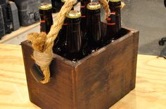 Would be neat on guest tables instead of wine! How to Make a Beer Tote: A Beginner's Woodworking Project Free Info On Wood Work D-I-Y Projects http://www.woodprofits.com/?hop=megairmone