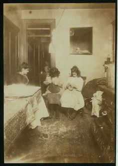 Florence Valentino, 12 yrs. old, and sister Jennie, working on crochet hats in dirty kitchen tenement, 3126 Jerome Ave. (Bronx). They make heavy hats, muffs, scarfs, slippers, etc. Jennie, 15 yrs. old, works in a Tremont Av. factory part of the time. Can make 1Πdozen heavy hats in half a day. Florence makes five hats in half a day, being in school only half a day. Have been at it one year. Location: New York, New York (State). Date Created/Published: 1911 December. LOC original medium: 1 photog