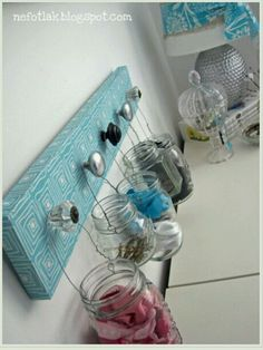 Mason jars hung for organization of bobby pins, scrunchies, any hair accessories