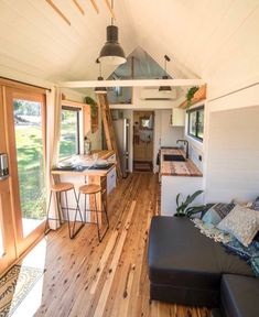 """Sojourner"" Tiny House by Australian-based Häuslein Tiny House Co. The ""Sojourner"" Tiny House by Australian-based Häuslein Tiny House Co.The ""Sojourner"" Tiny House by Australian-based Häuslein Tiny House Co. Casas Containers, Best Tiny House, Small Tiny House, Pine Floors, Tiny House Living, Tiny House Bedroom, Small Living, Tiny House Design, Small Room Design"