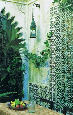 """Moroccan arched opening and Tunisian tiles in courtyard of architect Roberto Peregalli's 18th c. home called """"The House of Whispers"""" in Tangier, Morocco (Photograph by Roland Beaufre for """"World of Interiors"""" magazine)"""