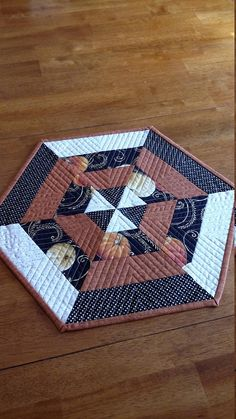 """Autumn Table Topper, Pumpkin Hexi , size 16"""", Black, Orange, and Cream with Metallic Gold accent, Quiltsy Handmade"""
