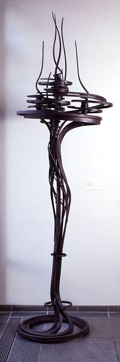 Albert Paley American, (Philadelphia, Pennsylvania, 1944 - ) Candlestick, 1977 American Sculpture Mild steel, forged 111 in. x 35 in. (281.94 cm x 88.9 cm)