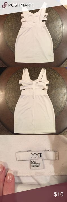 White Dress w/ Strappy Cutouts Cute white dress with side/back strap cutouts. It's really cute on! Size L, but could fit a M. It does look a little worn - just looks like it has the little fuzzies on it. Accepting offers! Forever 21 Dresses