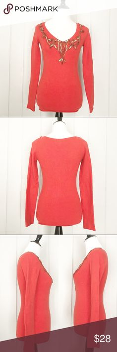 We the Free by Free People Orange V Neck Sweater Cute soft and cozy is this We The Free by Free People rusty orange v neck sweater with detail yarn neckline and rounded hem.  See pictures for measurements. Free People Sweaters V-Necks