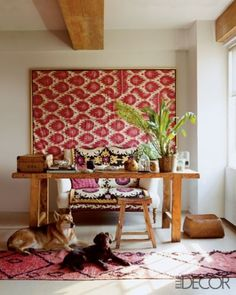 gorgeous fabrics enliven this rustic desk (the dogs help too!); 40 Floppy But Refined Boho Chic Home Office Designs | DigsDigs