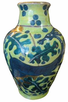 Edouard Cazaux (1889 - 1974) Ceramic Vase Ceramic vase with painted decoration featuring dark blue-green deer and foliage on a lighter green ground, with golden accents. Signed CAZAUX on bottom of vase Height: 11 ¼ in (28.6 cm) Diameter at widest point: 6 ¾ in (17 cm) Diameter of mouth: 3 ¼ in (8.3 cm)