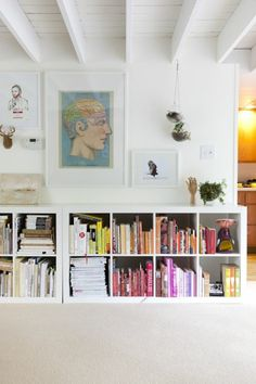 Ikea done right. downstairs / horizontal ikea expedit bookshelves in kate jordan and david chanpong's home in philadelphia; photo by nick steever. Ikea Expedit Bookcase, Ikea Kallax, Ikea Shelves, Expedit Regal, Kallax Shelving, Cube Shelves, White Shelves, Low Bookshelves, Cheap Bookcase