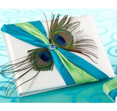 Complete your peacock theme wedding with this Peacock Guest Book!