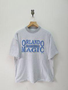 Vintage 90's Orlando Magic NBA Team T-Shirt by RetroFlexClothing