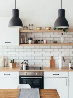 Looking for a #modern #scandanavian feel for your #kitchen? We've got you covered. North Cabinetry Killington is a clean, flat panel door. Pair it with an #organic element like wood #countertops and minimal #hardware and you'll be #cooking in your inspired #scandanaviandesign in no time! . #butcherblockcountertop #scandanaviankitchen #kitchendesign #backsplashdesign #kitchencabinetry #cabinetry #openshelving #kitchen #designswelove #Modernkitchen #modernhome #scandanavianhome House Cleaning Tips, Spring Cleaning, Cleaning Hacks, Kitchen Rails, Open Kitchen Shelving, Clean Baking Pans, Cleaning Painted Walls, Glass Cooktop, Clean Dishwasher