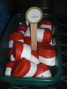 fishing party food--- bobbers using marshmallows dunked in red candy melts