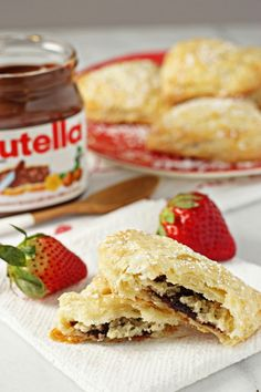 Recipe for nutella strawberry hand pies. Buttery, flaky pie crust stuffed with sliced strawberries, sweetened up mascarpone and nutella. Monster Cook, Cookie Monster, Just Desserts, Delicious Desserts, Strawberry Hand Pies, Nutella Recipes, Bread And Pastries, Baked Empanadas, Food To Make