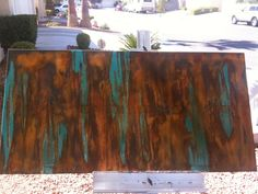 Rust activated paint on canvas that my wife did.......  it was a lot easier than you could imagine.