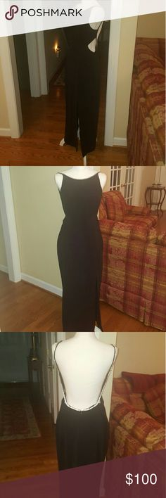 """Black elegant jeweled JS  Collections gown 12 Beautiful and elegant long JS  Collections gown. Size 12.  44.5"""" from armpit to hem. In beautiful excellent condition no signs of wear.  Sexy side cut outs, bra pads sewn in!!! Perfect dress for a cocktail party formal, homecoming or prom.  Would be happy to give more measurements or pics for serious inquiries. JS Collections Dresses Maxi"""