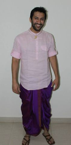 Traditional #Indian wear with a twist… dhoti meets short, #pink #kurta with button-up sleeves and #Jaipur #chappals #fashion #style #men