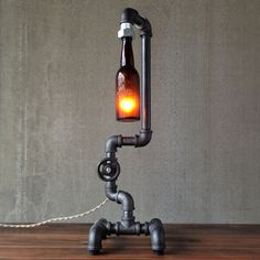 Fuse Beer Bottle Table Lamp - consists of a pre-prohibition era beer bottle attached to an iron pipe base and a vintage faucet handle; includes a tag that details the history of the brewery it came from - so cool for a man cave