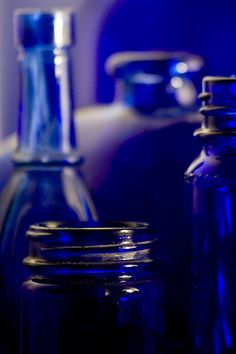 i have a collection of cobalt jars & vases from my grandma, mom & aunt.. many are antiques, and i just love the way the light catches them.