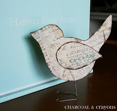 easy paper bird diy - made from paperclips and scrapbook paper. you could do this with old book pages too!