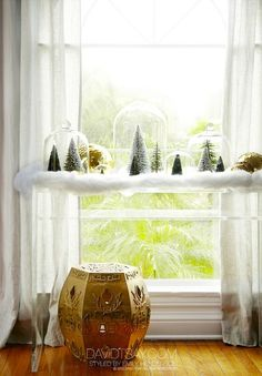 cloche and frosted trees...sweet (via Home For The Holidays With HGTV's Emily Henderson | theglitterguide.com)