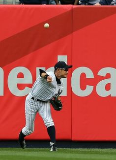 Ichiro Suzuki #31 of the New York Yankees sends the ball in to catch the runner at home in the 2nd inning against the Baltimore Orioles on April 13, 2013 at Yankee Stadium in the Bronx borough of New York City. (Photo by Elsa/Getty Images)
