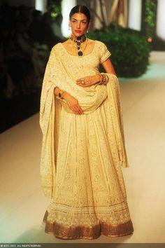 Model Indrani Dasgupta displays a creation by designer Meera Muzaffar Ali on Day 2 of India Bridal Fashion Week in New Delhi on July 24, 2013