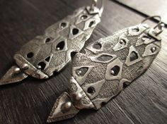 Pierced Mud Cloth Earrings by Celie Fago      These textured sterling silver earrings feature a mud cloth design, some of which has been cut out to add visual interest and keep the earrings lightweight. They are bold and intricate, and have a soft satin finish.  Sterling.