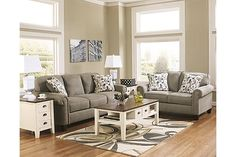 """The Gusti Loveseat from Ashley Furniture HomeStore (AFHS.com). With the stylish comfort of sleek rolled arms and plush back cushions supported by rich finished accent wood feet, the """"Gusti-Dusk"""" upholstery collection uses soft upholstery fabric surrounding a relaxed contemporary design to create a warm inviting collection that fits comfortably into any home."""