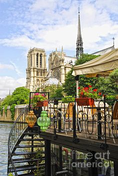 Restaurant on a boat on river Seine with the view of Notre Dame de Paris Cathedral in Paris France
