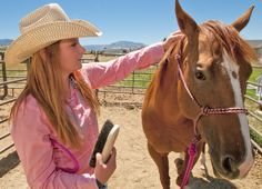 Madi Funk grooms her horse, Macie, at her Paradise, Utah, home. The 16-year-old recently competed in High School National Finals Rodeo in Reined Cow Horse. (Photo by John Zsiray)