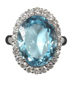 18CT WHITE GOLD AQUAMARINE AND DIAMOND CLUSTER RING at Ross's Online Art…