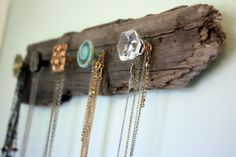 DIY Necklace Holder - For a unique way to hang your necklaces, try using a board with decorative knobs.