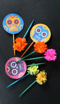Dia de los Muertos/Day of the Dead sugar skull cupcake toppers and mini paper flowers.