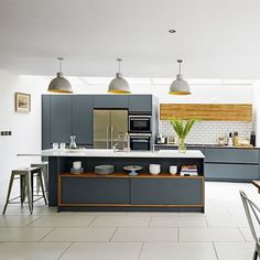 Looking for grey kitchen ideas? If you're looking for an alternative to white kitchen units, you can't go wrong with grey cabinetry and grey kitchen tiles Painting Kitchen Cabinets, Kitchen Paint, Kitchen Tiles, Kitchen Units, Kitchen Cupboards, Kitchen Storage, Kitchen Appliances, Grey Kitchen Designs, Modern Kitchen Design