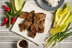 NYT Cooking: This dish, known as galbi, is a fine thing to eat in a restaurant, but it also makes for a wonderful and easy meal at home. If you buy English-style short ribs, which are cut along the bone, you must butterfly the meat into a thin, long strip. If the ribs you buy are flanken-style, in which a band saw is used to cut across the ribs, creating half-inch slice...