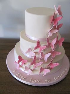 Pink Butterfly theme Wedding cake  - Fondant 3 tier ivory cake with gumpaste butterflies :)