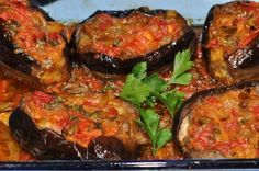 Imam Bayildi (The Priest Fainted) - A Turkish eggplant dish - eggplant stuffed with ground beef, tomatoes, greeen peppers, onions, and parsley