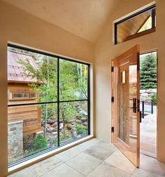 This contemporary mountain home in Vail Village, CO melds mountain rustic with contemporary design. Arrigoni Woods crafted and installed Bavarian Oak wide-plank engineered flooring, wire-brushed with a custom finish. The reclaimed wood sunburnt siding on the exterior is also by Arrigoni Woods. Floor to ceiling windows create a seamless transition from outdoors to indoors. Images by Gibeon Photography.