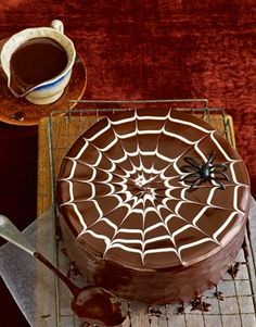 For a wickedly good spider web, pour Chocolate Glaze over the top of a layered halloween cake. None of your guests will be able to take their hands off this delicious cake.