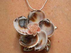 Handmade Seashell Flower Pendant with Sterling Silver Chain. $25,00, via Etsy.