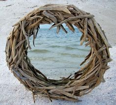 Driftwood mirror- I want one soooo badly.  I might have to give up looking and attempt to make one.