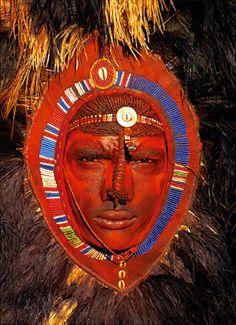 Africa | Massai warrior with red ochre face paint.  Kenya | © Carol Beckwith & Angela Fisher
