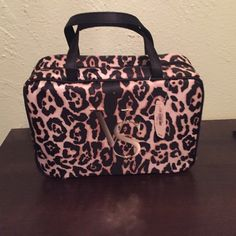"""Victoria's Secret cosmetic bag Cheetah print cosmetic bag with the VS logo on the front. It is 11"""" length wise and 8"""" tall. Two compartments on the inside to carry all of your stuff. Victoria's Secret Bags Cosmetic Bags & Cases"""