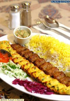 Kabab koobideh (Persian: کباب کوبیده) or kūbide (Persian: کوبیده) is an Iranian minced meat kabab which is made from ground lamb, beef or chicken, often mixed with parsley and chopped onions. Food Recipe Share and enjoy! Turkish Recipes, Greek Recipes, Indian Food Recipes, Middle East Food, Middle Eastern Recipes, Iran Food, Iranian Cuisine, Eastern Cuisine, Cooking Recipes
