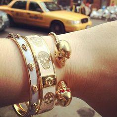 Alexander McQueen skull bracelets, apparently.  Want.