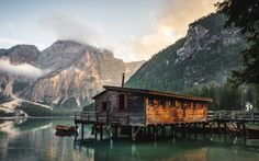 Cabin on Lago di Braies reflects in the still waters