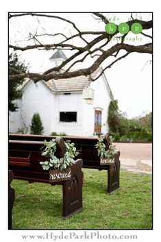 "Love these ""reserved"" signs hanging on vintage church pews with leafy wreaths! Photo by @hydeparkphoto. See more at http://www.hydeparkphoto.com/barr-mansion-brunch-wedding/ 